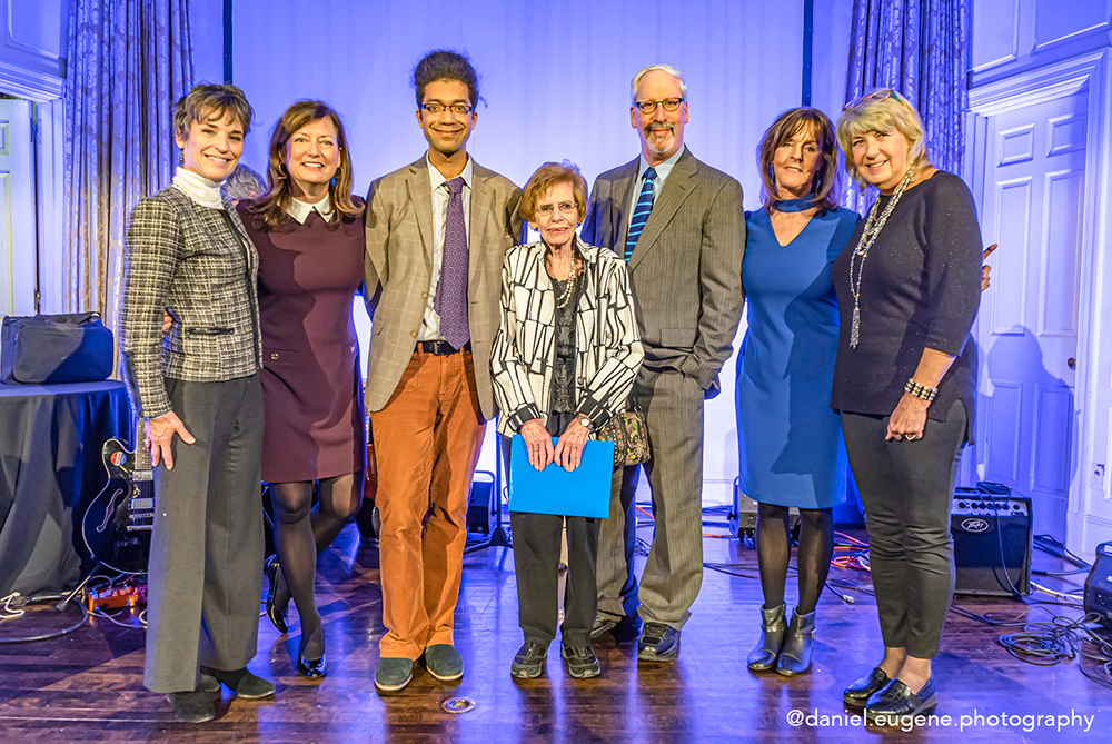 Photo of Bitsie Clark, center, is flanked by the two 2019 winners of the Bitsie Clark Fund for Artists grant: Adam Matlock (L) and Harold Shapiro (R). From left to right, the Bitsie Chicks: Robin Golden, Maryann Ott, Mimsie Coleman, Barbara Lamb. Photo credit: Daniel Eugene